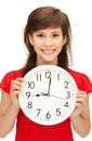 Teenage girl holding big clock