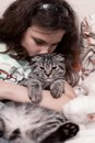 Teenage girl holding kitten Royalty Free Stock Photo