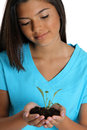 Teenage Girl Holding Plant Stock Photo