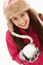 Teenage Girl Holding Snowball Wearing Fur Hat Stock Photo