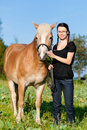Teenage girl with horse Stock Photo