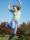 Teenage girl jumping in air