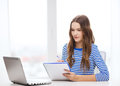 Teenage girl laptop computer and notebook Royalty Free Stock Photo