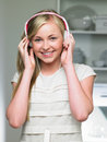 Teenage girl listening to music on headphones smiling camera Royalty Free Stock Photo