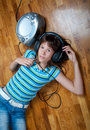 Teenage girl listens to music Stock Image
