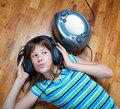 Teenage girl listens to music Royalty Free Stock Photography