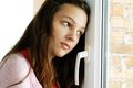 Teenage girl looking out  window Royalty Free Stock Photo