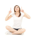 Teenage girl looking and pointing up, full length Royalty Free Stock Image