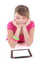 Teenage girl lying and using tablet pc Royalty Free Stock Images