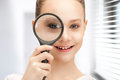 Teenage girl with magnifying glass Royalty Free Stock Photo