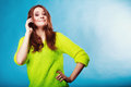 Teenage girl with mobile phone talking technology and communication happy woman on using smartphone on blue Royalty Free Stock Photo
