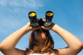 Teenage girl observing nature with binoculars Royalty Free Stock Photo
