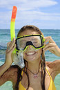 Teenage girl in the ocean with mask Stock Images