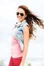 Teenage girl outside summer holidays and concept in shades Stock Images