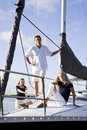 Teenage girl and parents on sailboat at dock Stock Photos