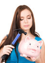 Teenage girl with piggy bank and hammer Royalty Free Stock Photography