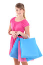 Teenage girl in pink after shopping over white Stock Images