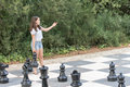Teenage girl playing giant outdoor chess Royalty Free Stock Photo