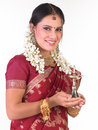 Teenage girl with sari and flowers holding lamp Royalty Free Stock Images