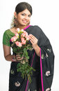 Teenage girl in sari with pink roses Royalty Free Stock Photo