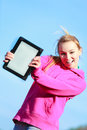 Teenage girl showing blank tablet outdoor fitness woman sport in pink tracksuit copy space screen of touchpad computer electronic Stock Photography