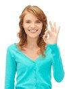 Teenage girl showing ok sign bright picture of Stock Image