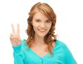 Teenage girl showing victory sign Royalty Free Stock Images