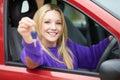 Teenage Girl Sitting In Car Holding Key Royalty Free Stock Photo