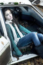 Teenage girl sitting in a car Royalty Free Stock Photo