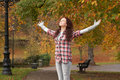 Teenage Girl Standing In Autumn Park Stock Photography