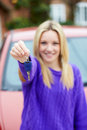 Teenage girl standing next to car holding key happy up camera smiling Royalty Free Stock Photos