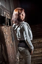 Teenage girl standing on stairs at old abandoned building Stock Photos