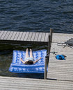 Teenage Girl Sunbathing on Raft at Lake Royalty Free Stock Image