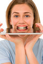 Teenage girl with tablet in mouth Stock Photography