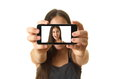 Teenage girl taking a selfie year old self portrait with her smartphone isolated on white Stock Images