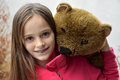 Teenage girl with teddy bear