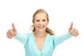 Teenage girl with thumbs up bright picture of Stock Photos