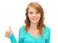 Teenage girl with thumbs up bright picture of Stock Images