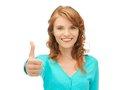 Teenage girl with thumbs up bright picture of Stock Photo