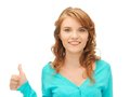 Teenage girl with thumbs up bright picture of Royalty Free Stock Photos