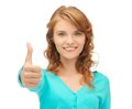 Teenage girl with thumbs up bright picture of Royalty Free Stock Photography