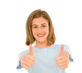 Teenage girl with thumbs up on white background Royalty Free Stock Photo