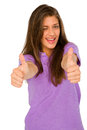 Teenage girl with thumbs up winking Stock Photos