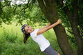 Teenage girl by tree Stock Image