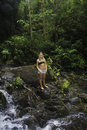 Teenage girl in a tropical forest Royalty Free Stock Photo
