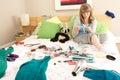 Teenage Girl In Untidy Bedroom Waxing Legs Royalty Free Stock Photo