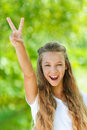 Teenage girl up two fingers Royalty Free Stock Photography