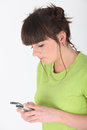 Teenage girl using cellphone Stock Photo