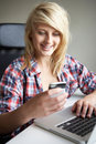Teenage Girl Using Laptop And Mobile At Home Royalty Free Stock Image