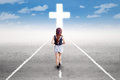 Teenage girl walking to the cross Royalty Free Stock Photo